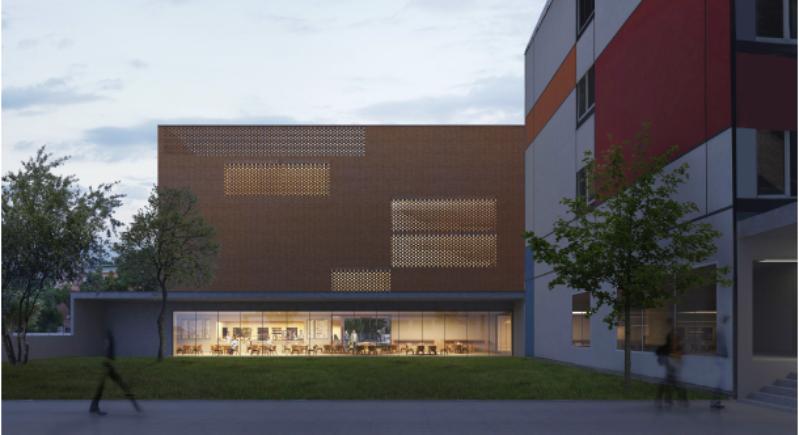 Az új épület tömege feszes vonalakkal elhúzottan, léptékhelyesen illeszkedik a meglévő épületek közé.